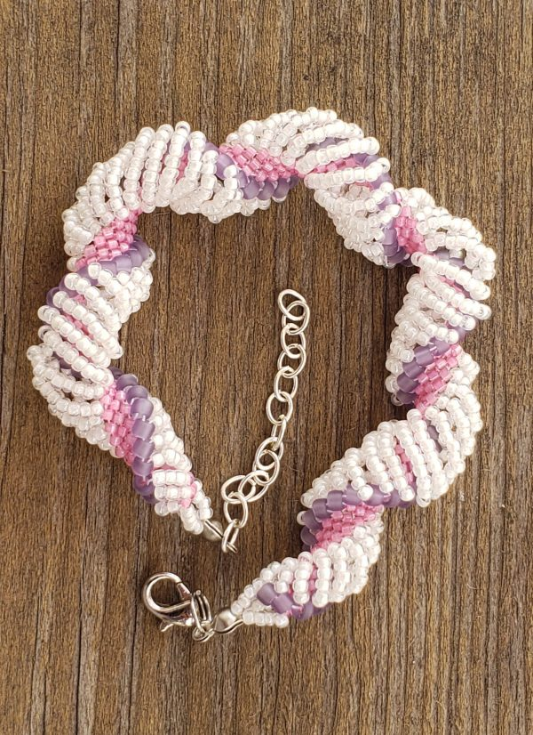Dutch Spiral seed bead bracelet in white, pink, and purple.